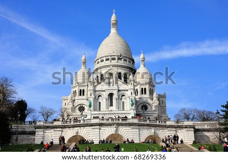 PARIS - MARCH 23 : Sacre Coeur Basilica in winter time on March 23, 2010 in Paris, France. Sacre Coeur Basilica is famous catholic church and popular landmark in Paris - stock photo
