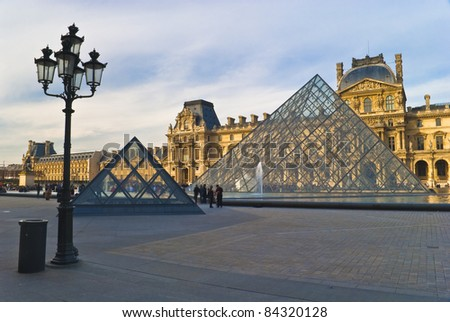 PARIS - March 20. Tourists enjoy the weather at the Louvre on March, 20, 2008 in Paris. The Louvre contains more than 380.000 objects and displays 35.000 artworks in eight departments..