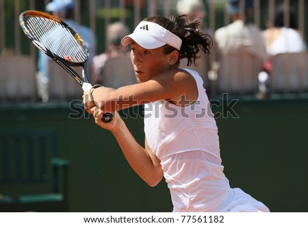 PARIS - MAY 19: Alexandra Cadantu of Roumania plays the 2nd round qualification match at French Open, Roland Garros on May 19, 2011 in Paris, France.