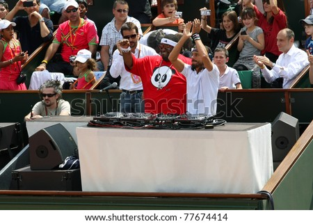 PARIS - MAY 21:Big Ali (L) and Bob Sinclar (R) dj at Court Philippe Chatrier during the exhibition matches at French Open, Roland Garros on May 21, 2011 in Paris, France.