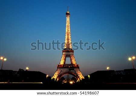 PARIS - MAY 20 : Eiffel tower at night on May 20, 2010 in Paris. The Eiffel tower is the most visited monument of France.