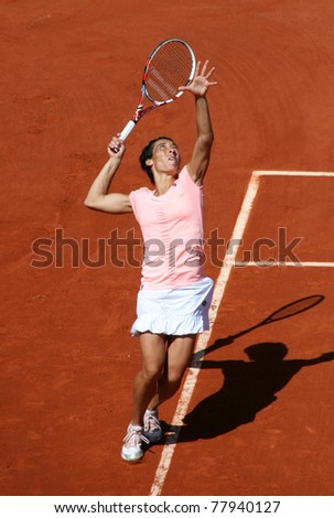 PARIS - MAY 23: Francesca Schiavone of Italy plays the 1st round match at French Open, Roland Garros on May 23, 2011 in Paris, France.