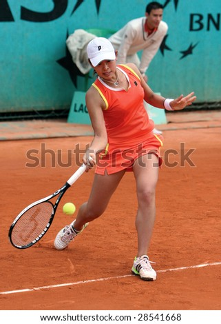 PARIS - MAY 21: Japanese professional tennis player JUNRI NAMIGATA during her match at French Open, Roland Garros on May 21, 2008 in Paris, France. - stock photo