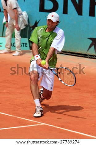 PARIS - MAY 23: Kazakhstan's professional tennis player Yuri Schukin returns the ball during the match at French Open, Roland Garros on May 23, 2008 in Paris, France.