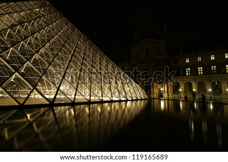 PARIS - MAY 8: Louvre Pyramid at dusk on May 8, 2012 in Paris, France. The Louvre is the biggest Museum in Paris
