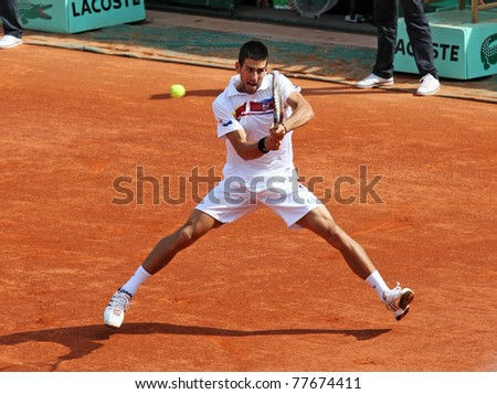 PARIS - MAY 21: Novak Djokovic of Serbia plays the exhibition match  at French Open, Roland Garros on May 21, 2011 in Paris, France.