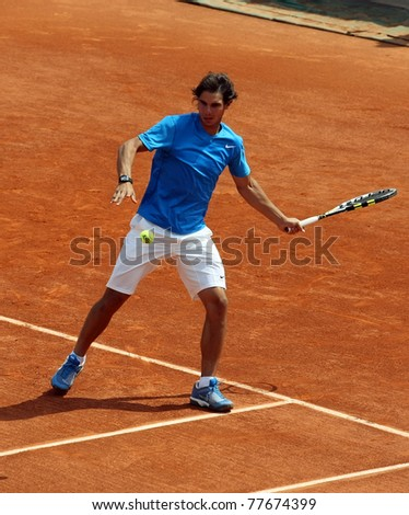PARIS - MAY 21: Rafael Nadal of Spain plays the exhibition match  at French Open, Roland Garros on May 21, 2011 in Paris, France.