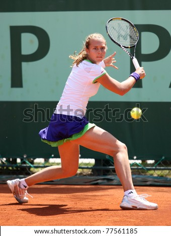 PARIS - MAY 19: Stefanie Voegele of Switzerland plays the 2nd round qualification match at French Open, Roland Garros on May 19, 2011 in Paris, France.