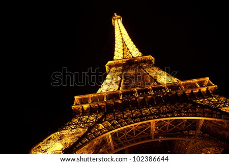 PARIS - MAY 09 The Eiffel tower at night on May 09, 2012 in Paris. The Eiffel tower is the most visited monument of France.