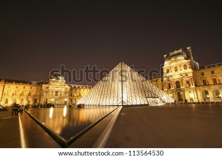 PARIS - MAY 15: The Louvre Pyramid shines at night on May 15, 2010 in Paris, France. The museum is housed in the Louvre Palace (Palais du Louvre) which began as a fortress built in the 12th century.