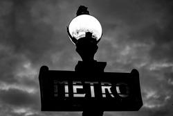 Paris Metro Station sign at sunset