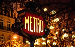 Paris Metro subway sign and Christmas illumination.