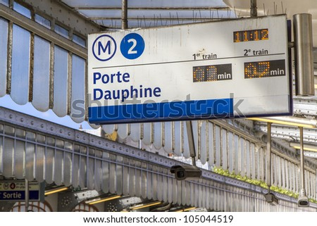 Paris Metro subway station with sign