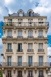 Paris, narrow building, typical parisian facade place de la Nation