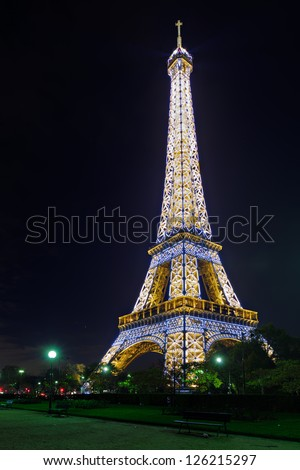 PARIS - NOV 08 : Illuminated Eiffel tower at midnight on November 8, 2012 in Paris. The Eiffel tower is the most visited monument of France.