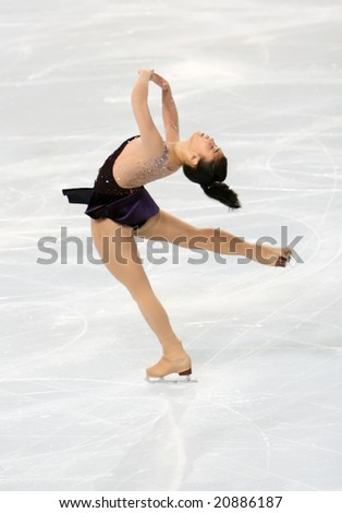 PARIS - NOVEMBER 14: American figure skater Beatrisa LIANG during the Ladies short skating event of the Eric Bompard Trophy November 14, 2008 at Palais-Omnisports de Bercy, Paris, France. - stock photo