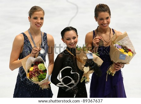 PARIS - NOVEMBER 19: Carolina KOSTNER (L), Elizaveta TUKTAMYSHEVA, Alissa CZISNY at the medal ceremony of ISU Grand Prix Eric Bompard Trophy on NOVEMBER 19, 2011 at Bercy, Paris, France.