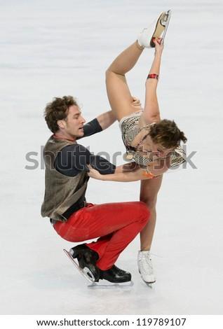PARIS - NOVEMBER 17: Nathalie PECHALAT / Fabian BOURZAT of France perform free dance at the ISU Grand Prix Eric Bompard Trophy on November 17, 2012 at Palais-Omnisports de Bercy, Paris, France.