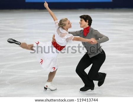 PARIS - NOVEMBER 16: Piper GILLES / Paul POIRIER of Canada perform short dance at the ISU Grand Prix Eric Bompard Trophy on November 16, 2012 at Palais-Omnisports de Bercy, Paris, France.