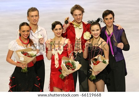 PARIS - NOVEMBER 27: RIAZANOVA/TKACHENKO (L), NPECHALAT/BOURZAT, CHOCK/ZUERLEIN at the medal ceremony of the ISU Grand Prix on November 27, 2010 at Palais-Omnisports de Bercy, Paris, France.