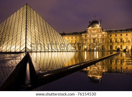 PARIS-NOVEMBER 1: The Louvre Pyramid and Museum at night, on November 1, 2009 in Paris, France. The pyramid serves as the main entrance to the Louvre Museum.