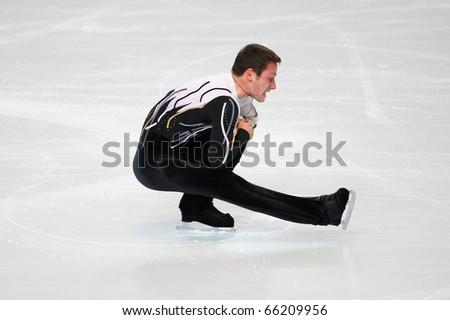 PARIS - NOVEMBER 26: Zoltan KELEMEN of Romania performs at men's short skating event at Eric Bompard Trophy on November 26, 2010 at Palais-Omnisports de Bercy, Paris, France.
