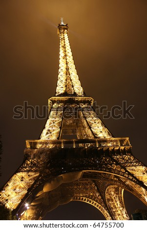 PARIS - OCT 28 : Illuminated Eiffel tower at night sky October 28, 2010 in Paris. The Eiffel tower is one of the most recognizable landmarks in the world.