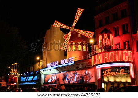 PARIS OCT 29 The Moulin Rouge by night on October 29 2010 in Paris France Moulin Rouge is a famous cabaret built in 1889 locating in the Paris red-light district of Pigalle