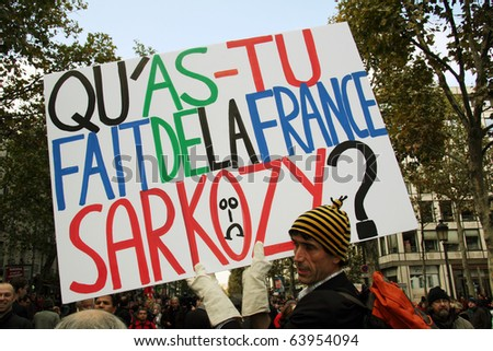PARIS - OCTOBER 28: A man holds the poster 'What have you done to France, Sarkozy' during the strike against the retirement age reform on October 28, 2010 in Paris, France