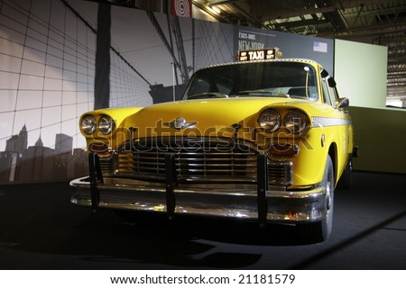 PARIS - OCTOBER 13 : People look at a Yellow cab taxi of new york at the 2008 Paris Motor Show October 13, 2008 in Paris.