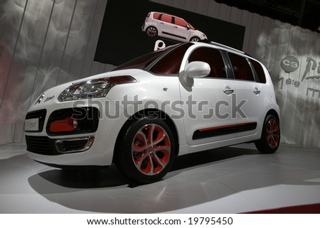 PARIS - OCTOBER 13 : People look at the Citroen C3 Picasso at the 2008 Paris Motor Show October 13, 2008 in Paris. The show attracts more of one million people every 2 years