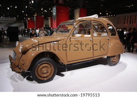 PARIS - OCTOBER 13 : People look at the Citroen 2CV Hermes at the 2008 Paris Motor Show October 13, 2008 in Paris. The show attracts more of one million people every 2 years