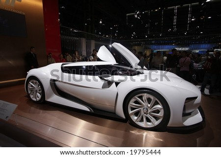 PARIS - OCTOBER 13 : People look at the Citroen Grandturismo at the 2008 Paris Motor Show October 13, 2008 in Paris. The show attracts more of one million people every 2 years