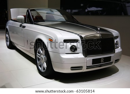 PARIS - OCTOBER 14: Rolls-Royce Phantom Drophead Coupe in Carrara White metallic with Bespoke design at the Paris Motor Show 2010 at Porte de Versailles, on October 14, 2010 in Paris, France