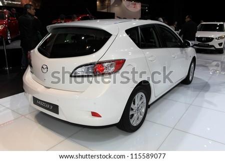 PARIS - OCTOBER 14: The new Mazda 3 displayed at the 2012 Paris Motor Show on October 14, 2012 in Paris - stock photo