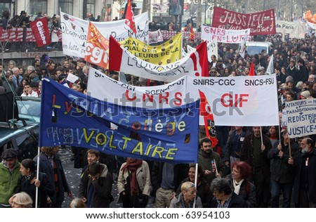 PARIS - OCTOBER 28: University and college students march during the strike against the retirement age reform on October 28, 2010 in Paris, France