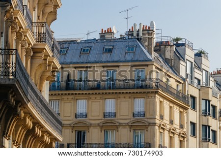 Paris residential buildings. Old Paris architecture, beautiful facade, typical french houses on sunny day. Famous travel destinations in Europe. City life, lifestyle and expensive real estate concept.