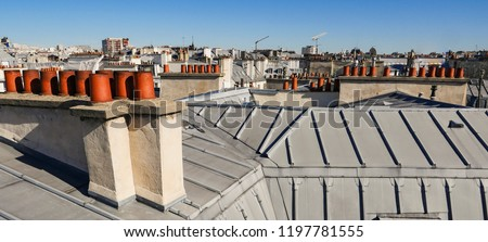 Paris roofs panoramic overview at summer day, France, traditional postcard picture, Europe