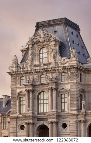 PARIS - SEPT. 22: Louvre museum building on September 22, 2011 at Louvre museum, France. It is consistently the most visited museum in the world with over 8 million annual visitors - stock photo