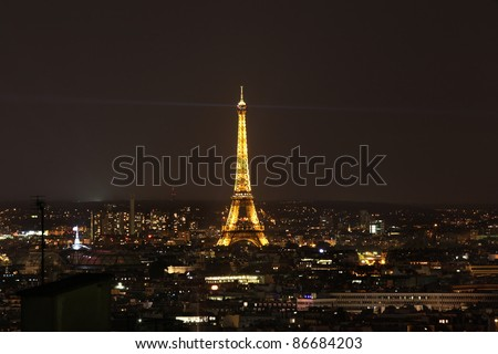 PARIS-SEPTEMBER 13: Eiffel Tower at night Sept 13,2011 Paris, France. Eiffel Tower and Light Show with around 20,000 light bulbs in the show.The Tower  is located on the Champ de Mars in Paris. - stock photo