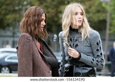 PARIS-SEPTEMBER 30, 2016. Elena Perminova is talking with Christina Centenera during the Paris fashion week.Loewe fashion show, Ready to wear.