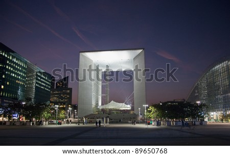 PARIS - SEPTEMBER 21: La Grande Arche in Paris at sunset on September 21, 2009. La Grande Arche is 110m high and was inaugurated in July 1989 - stock photo