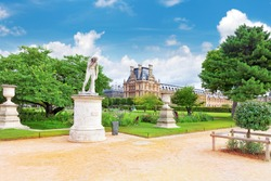 PARIS - SEPTEMBER 18: Louvre museum and park des Tuileries  on September, 18, 2013. The Louvre is the biggest museum in Paris with nearly 35,000 objects from prehistory to the 19th century .