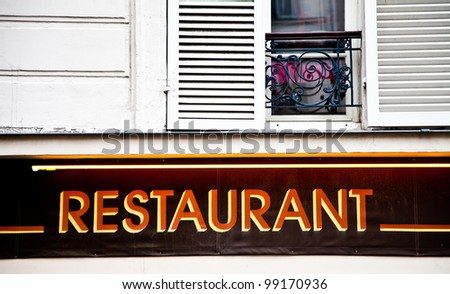 Paris - Sign of a Montmartre restaurant in traditional boulevard