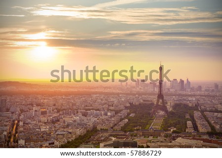 Paris skyline at sunset with Eiffel tower on the right