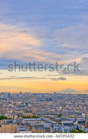 Paris skyline from the Sacre Coeur at a summer sunset.
