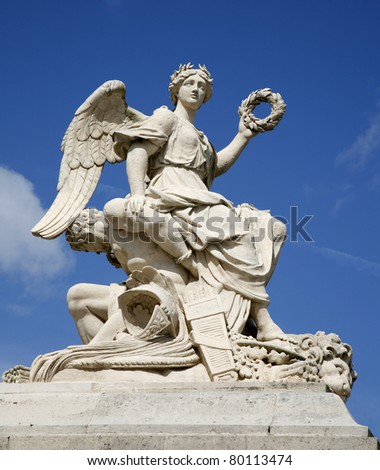 Paris - statue of angel from gate of Versailles palace - stock photo
