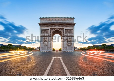 Shutterstock Paris street at night with the Arc de Triomphe in Paris, France.