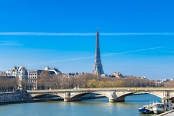Paris, the Invalides bridge on the Seine, with the Eiffel Tower in background