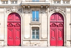 Paris, two wooden doors, typical building in the 7th arrondissement, a luxury district